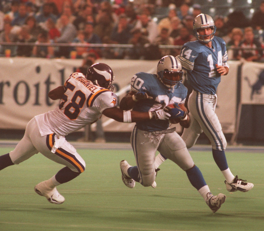 . Lions Barry Sanders  tears through the Vikings line for a big gainer to help the Lions Beat the Viks 38-15. Reaching for Barry is the Vikings, Ed Mc Daniel.