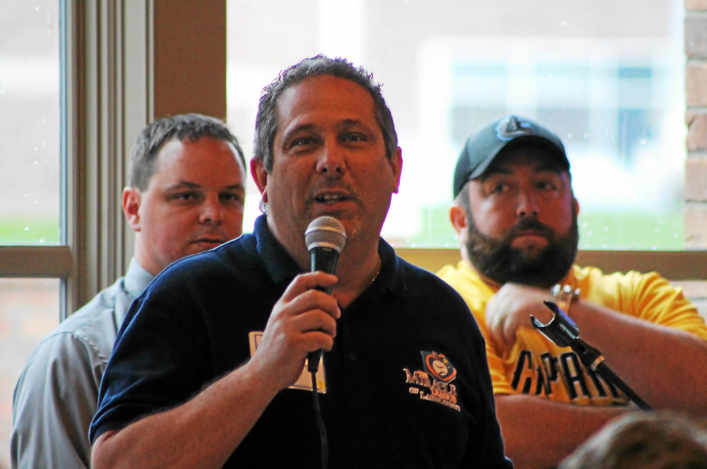 . Kristi Garabrandt � The News-Herald <br> Lake County Captains\' General Manager Neil Stein and Miracle League Board vice-president and fundraising chairperson Morris Beverage III look on as Eastlake Mayor Dennis Morley addresses the attendees at the Miracle League of Lake County\'s First Pitch fund-raiser, April 20, 2017.