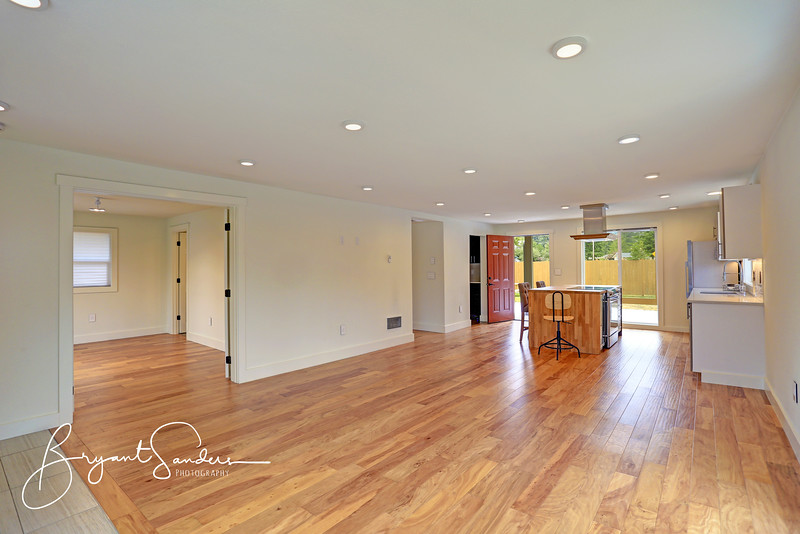 Open floor plan interior features a newly remodeled kitchen