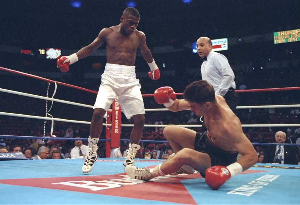 . 12 Apr 1997:  Floyd Mayweather stands over top of Bobby Geipert during a fight at the Thomas and Mack Center in Las Vegas, Nevada.  Mayweather knocked out Geipert in the first round. (Al Bello/Allsport)