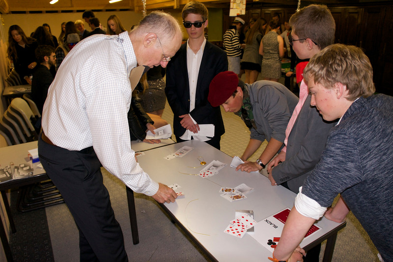Mr. Hansen playing Blackjack with Whit, Lucas, Ishvara, and Aidan
