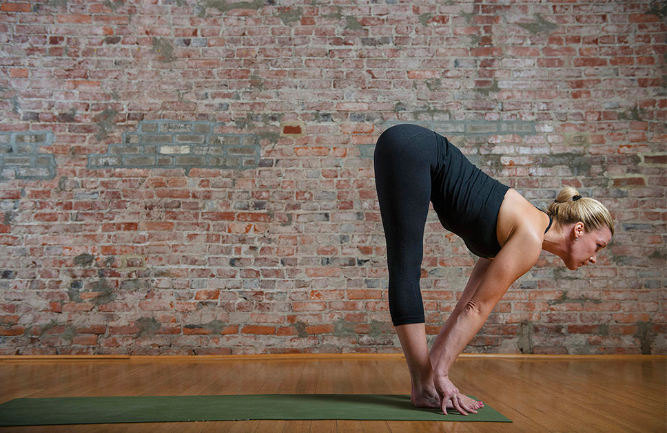 . Yoga instructor Mimi Rieger demonstrates a sun salutation sequence. Left to right:  4) Inhale again as you stretch your spine and bring your gaze forward.  (Photo for The Washington Post by Amanda Voisard.)
