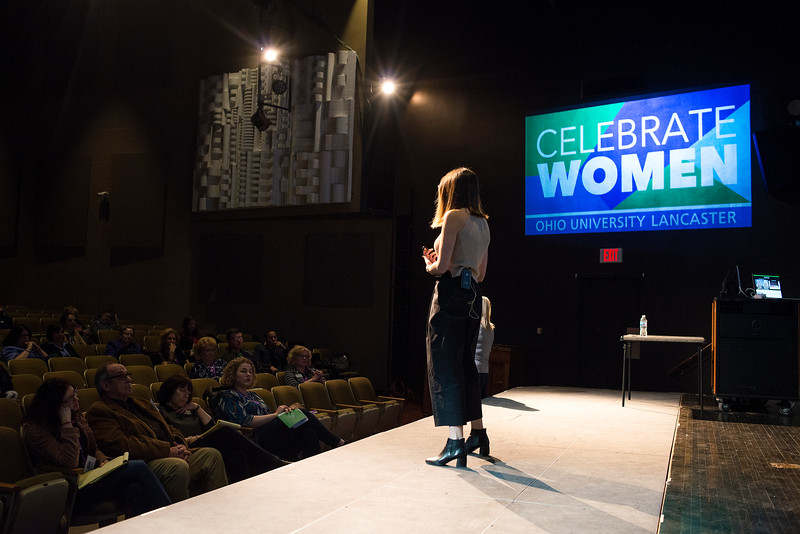 """LANCASTER, OHIO   MARCH 23, 2018: Michelle Poler, founder of Hello Fears, talks about how she faced 100 of her fears in 100 days in the Wagner Theatre as one of the keynote speakers during the Celebrate Women Conference 2018, themed """"Recognizing Our Superpowers"""" on March 23, 2018 at Ohio University Lancaster in Lancaster, Ohio.  Ty Wright photo"""