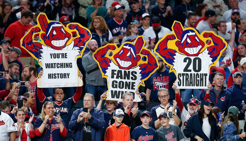 . Cleveland Indians fans celebrate a 2-0 victory over the Detroit Tigers in a baseball game, Tuesday, Sept. 12, 2017, in Cleveland. The Indians won their 20th game in a row, tying the American League record. (AP Photo/Ron Schwane)