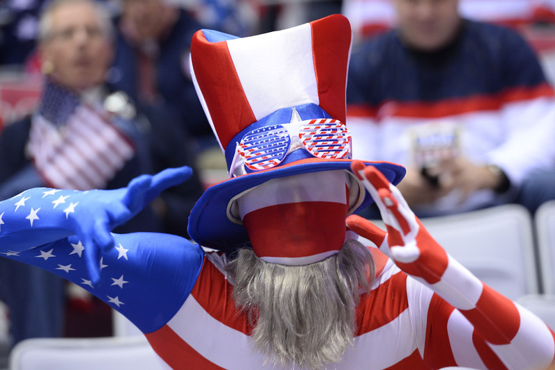 . A US supporter cheers before the start of the Men\'s Ice Hockey Semifinal match between the USA and Canada at the Bolshoy Ice Dome during the Sochi Winter Olympics on February 21, 2014.  JONATHAN NACKSTRAND/AFP/Getty Images
