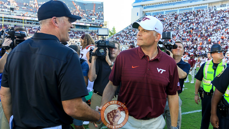 Virginia Tech head coach Justin Fuente shakes hands at midfield with ODU head coach Bobby Wilder after the end of the game. (Mark Umansky/TheKeyPlay.com)