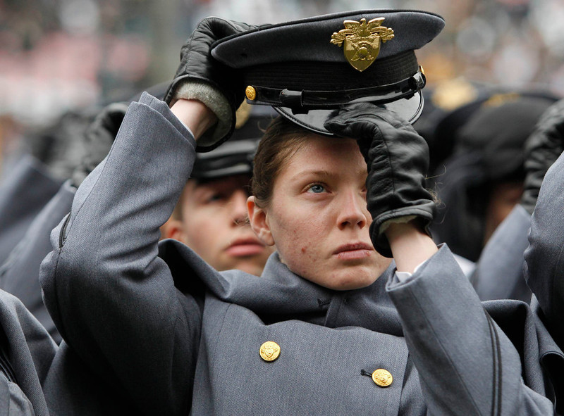 . A cadet from the United States Military Academy removes her hat during formation, before the start of the Army versus Navy NCAA football game in Philadelphia, Pennsylvania, December 8, 2012. REUTERS/Tim Shaffer