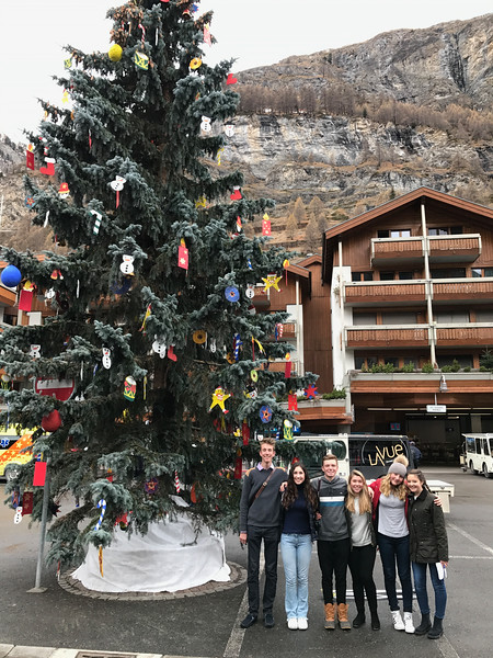 Scavenger hunt group in front of the town's Christmas tree