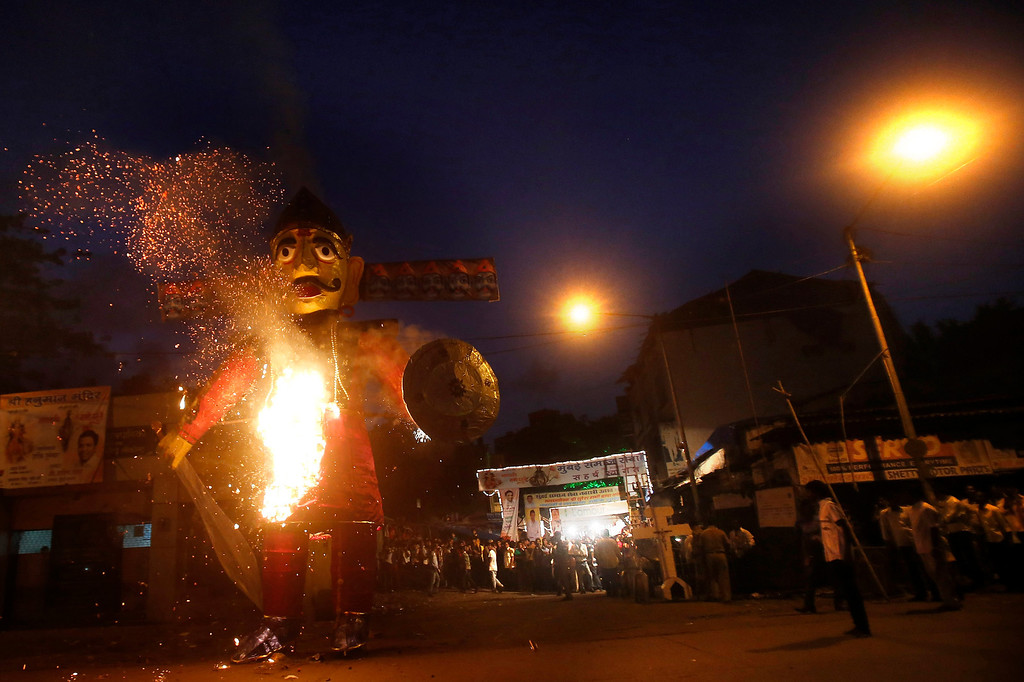 . An effigy of the ten-headed demon king Ravana burns during Dussehra celebrations in Mumbai, India, Sunday, Oct 13, 2013. Dussehra festival commemorates the victory of Hindu god Rama over Ravana. The burning of effigies of Ravana, signifying the victory of good over evil, brings the festivities to a close.(AP Photo/Rafiq Maqbool)