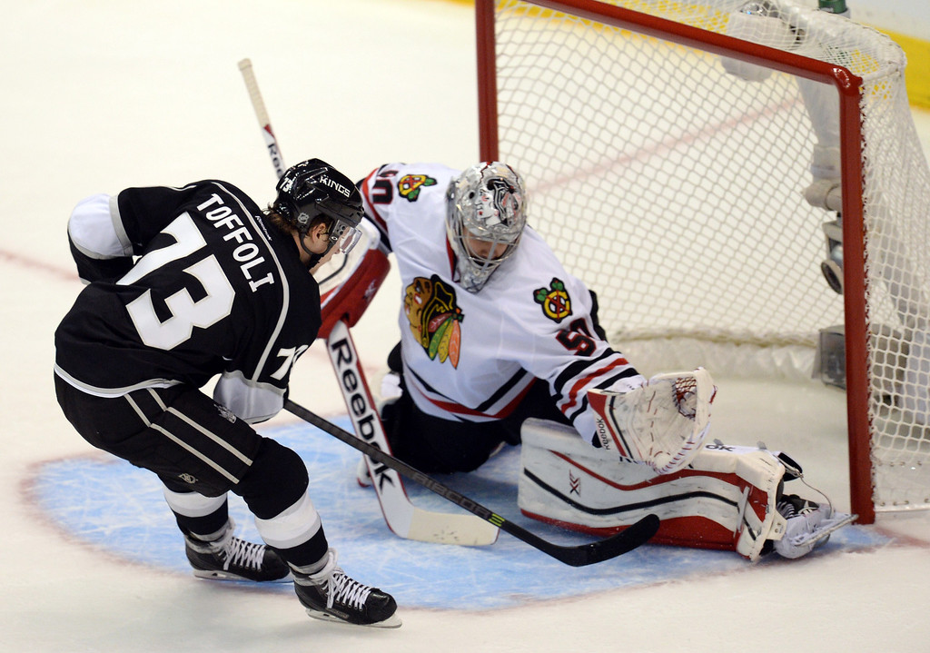 . The Kings� Tyler Toffoli #73 gets the puck past Blackhawks� goalie Corey Crawford #50 for a second period goal during Game 3 of the Western Conference finals at the Staples Center on Saturday, May 24, 2014. (Photo by Hans Gutknecht/Los Angeles Daily News)