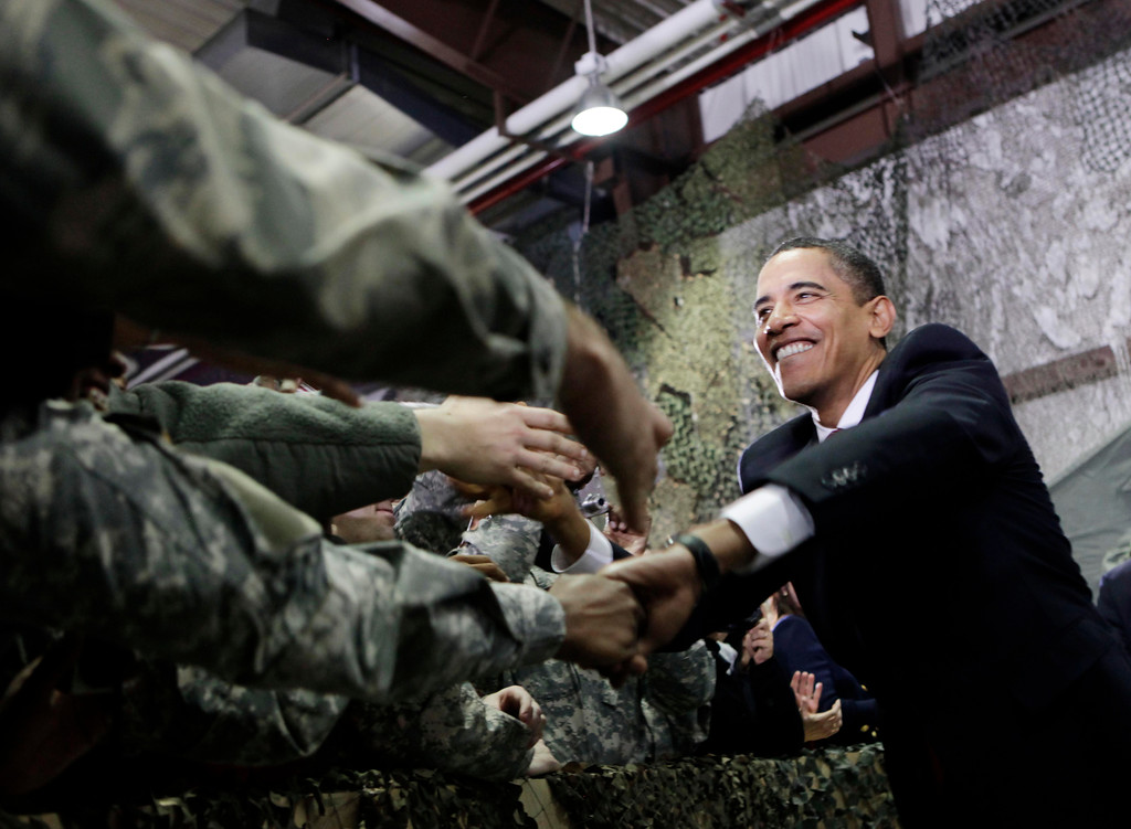 . U.S. President Barack Obama shakes hands with U.S. service members during his visit at Osan Air Base in Osan, outside Seoul, South Korea, Thursday, Nov. 19, 2009. (AP Photo/Pablo Martinez Monsivais)