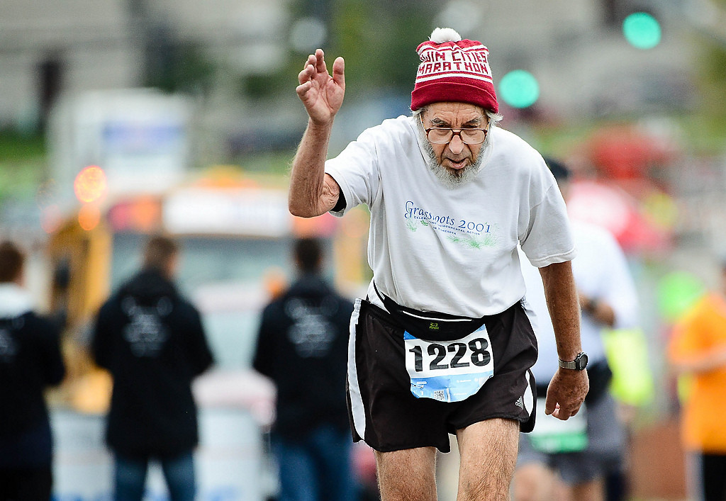 . 80-year-old Roger Aiken of Falcon Heights was among the last to finish the Twin Cities Marathon in St. Paul on Sunday, October 6, 2013. (Pioneer Press: Ben Garvin)