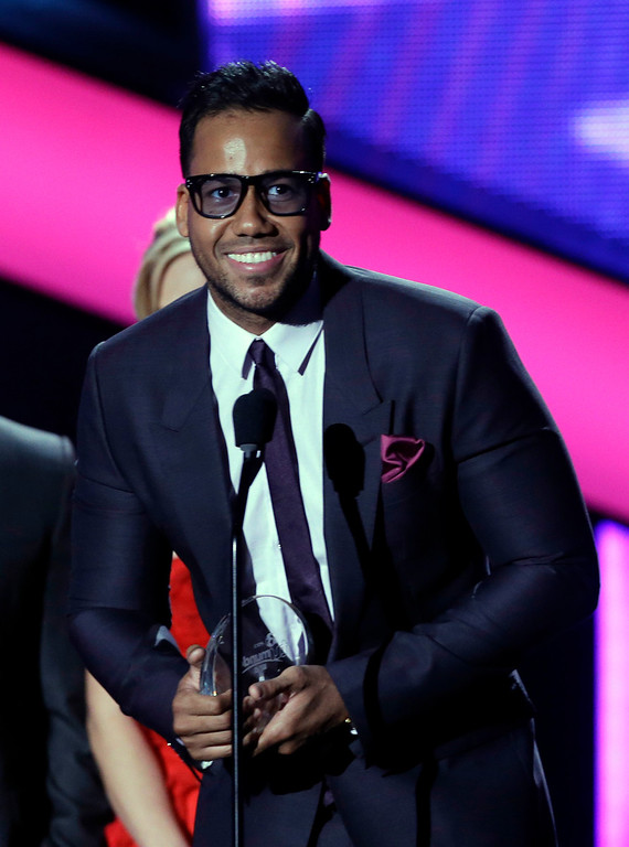 . Singer Romeo Santos receives the Tropical Album of the Year at the Latin Billboard Awards in Coral Gables, Fla., Thursday April 25, 2013. (AP Photo/Alan Diaz)