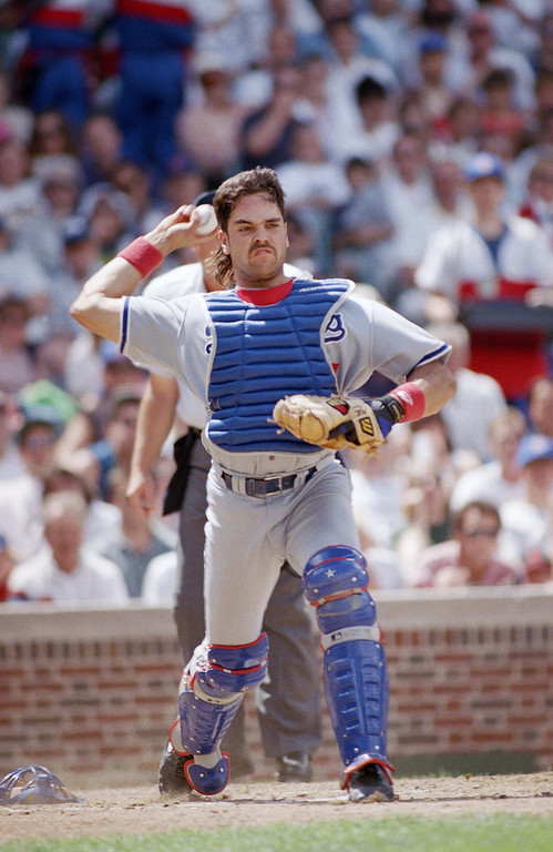 . MIKE PIAZZA -- Los Angeles Dodgers catcher Mike Piazza fires off to first base on a droped third strike during the fourth innings against the Chicago Cubs on June 11, 1994 in Chicago. (AP Photo/John Swart)