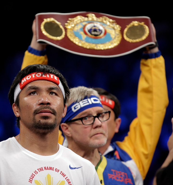 . Manny Pacquiao, from the Philippines, gets ready before the welterweight title fight against  Floyd Mayweather Jr., on Saturday, May 2, 2015 in Las Vegas.  (AP Photo/Isaac Brekken)