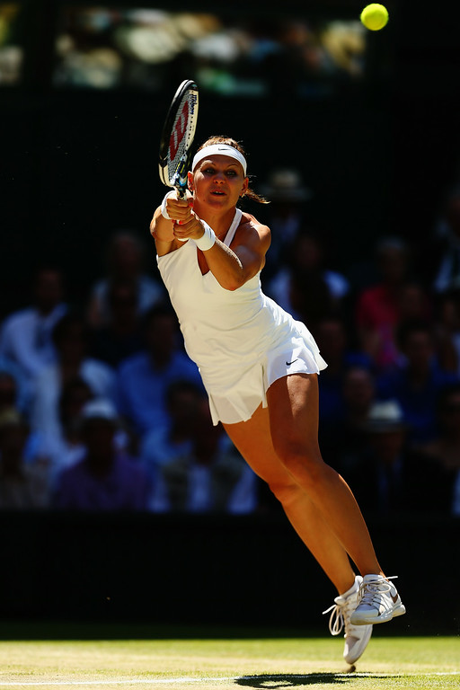 . Lucie Safarova of Czech Republic plays a backhand return during her Ladies\' Singles semi-final match against Petra Kvitova of Czech Republic on day ten of the Wimbledon Lawn Tennis Championships at the All England Lawn Tennis and Croquet Club  on July 3, 2014 in London, England.  (Photo by Clive Brunskill/Getty Images)
