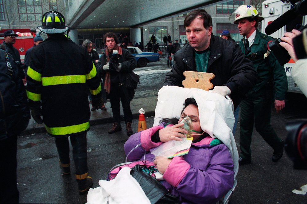 Description of . An injured woman is assisted out of the World Trade Center after a blast ripped through the world's second tallest office complex, killing six people and injuring more than 1,000 people in New York, in this February 26, 1993 file photograph. The Port Authority of New York and New Jersey will commemorate the 20th anniversary of the 1993 World Trade Center bombing on February 26, with a tribute to the six victims and an unborn child who lost their lives during the attack.  REUTERS/Greta Pratt