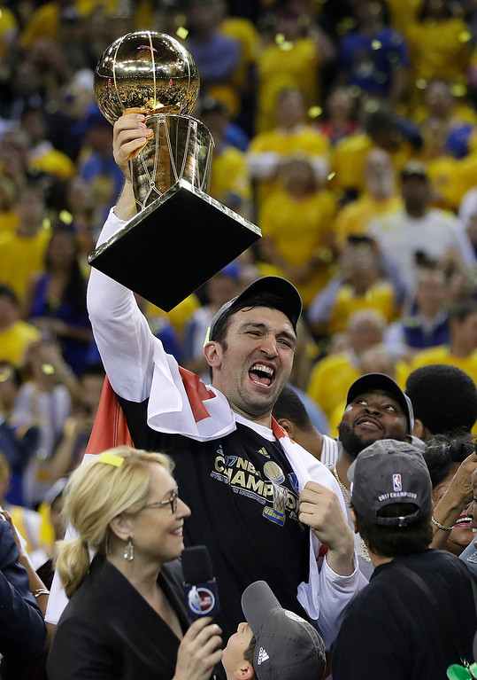 . Golden State Warriors center Zaza Pachulia holds the Larry O\'Brien NBA Championship Trophy after Game 5 of basketball\'s NBA Finals against the Cleveland Cavaliers in Oakland, Calif., Monday, June 12, 2017. The Warriors won 129-120 to win the NBA championship. (AP Photo/Marcio Jose Sanchez)