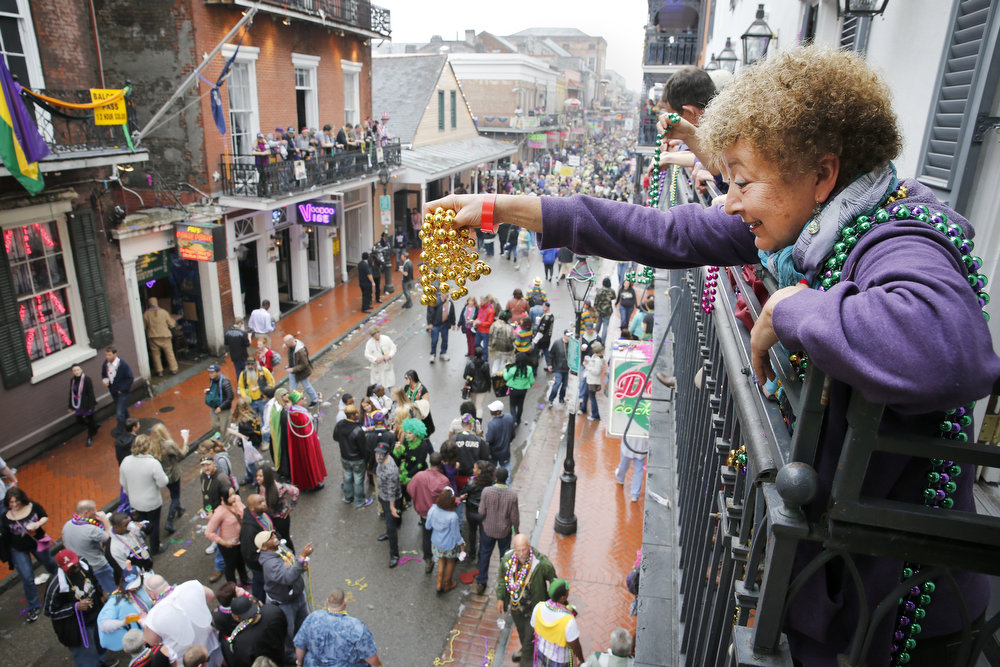 Description of . A Mardi Gras reveler dangles a pair of beads off of a balcony on Bourbon Street in New Orleans on Mardi Gras Day. Fat Tuesday, the traditional celebration on the day before Ash Wednesday and the beginning of Lent, is marked in New Orleans with parades and marches through many neighborhoods in the city. (Photo by Rusty Costanza/Getty Images)
