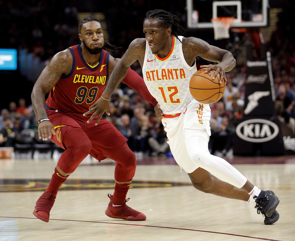 . Atlanta Hawks\' Taurean Prince (12) drives against Cleveland Cavaliers\' Jae Crowder (99) in the first half of an NBA basketball game, Sunday, Nov. 5, 2017, in Cleveland. (AP Photo/Tony Dejak)