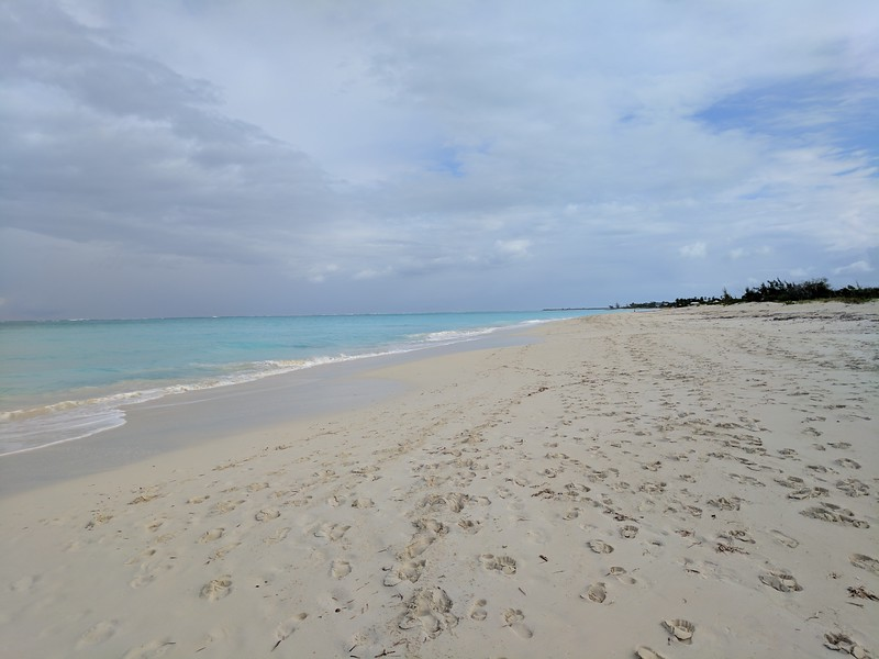 Boomer travel - beach vacations - Grace Bay in Turks and Caicos offers a wide sandy beach. If you're planning a tropical boomer vacation, this is the place!