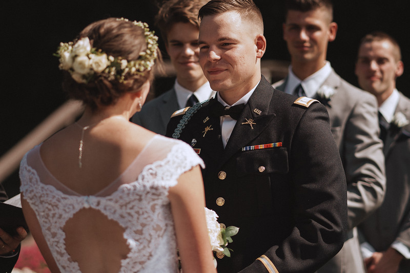Groom smiling at his bride.