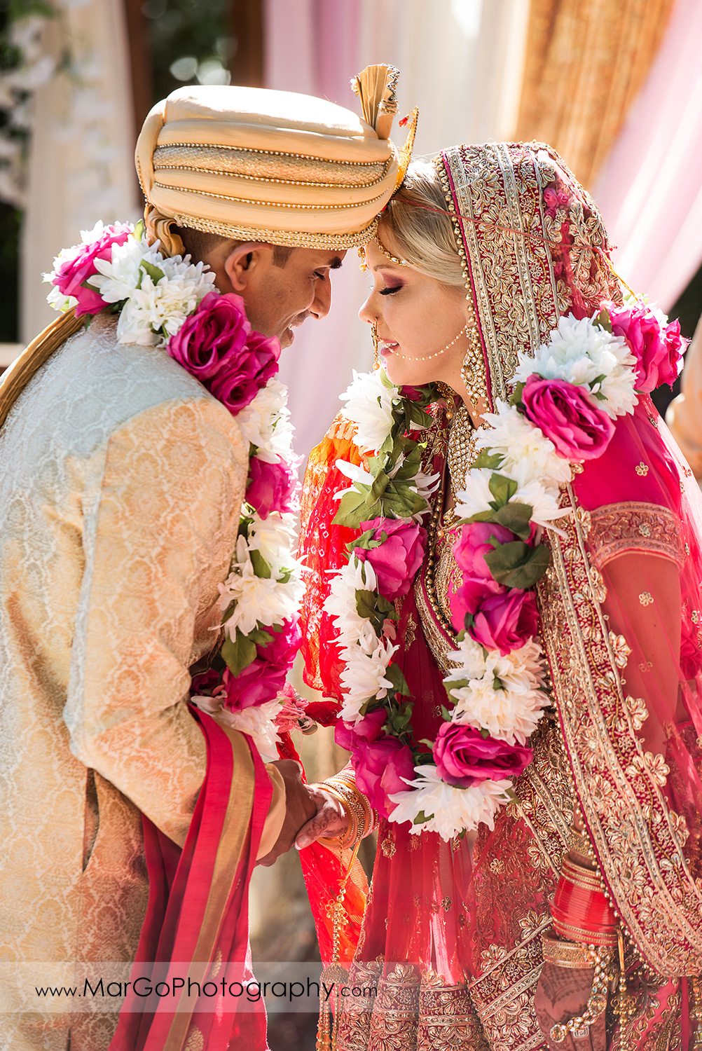 Indian bride and groom touching heads during Saptapadi - seven sacred steps at Elliston Vineyards in Sunol