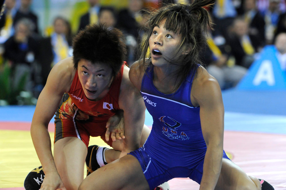 . (HR) ABOVE: Clarissa Chun, in blue, goes up against powerhouse Chiharu Icho of Japan. Clarissa Chun (Honolulu, Hawaii) wrestled for the bronze medal in the women\'s 48 kg class Saturday afternoon, August 16, at 4:30 p.m. She began the day with a victory over Sofia Mattsson of Sweden 2-1, 4-1, then scored a 6-1, 2-1 win over Vanessa Boubryemm of France. She then lost in the semifinals to Chiharu Icho of Japan 1-0, 0-1, 1-1, setting up her bronze medal match in the afternoon.  Chun, however, lost her bout  and finished her Olympic wrestling tournament in fifth place in the women\'s 48 kg class after being defeated by 2004 Olympic gold medalist Irini Merleni of the Ukraine. Merleni recorded a victory by fall on Chun 1:06 into the second period of the match.  Helen H. Richardson/The Denver Post