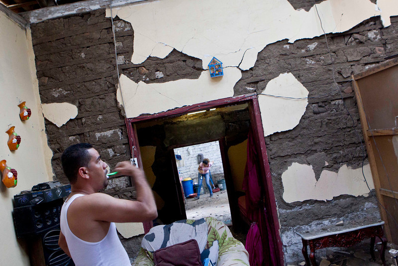 . A man brushes his teeth inside his home, damaged by an earthquake in Nagarote, Nicaragua, Friday, April 11, 2014. Nicaragua\'s President Daniel Ortega declared red alert Friday after an earthquake of 6.2 magnitude on the Richter scale that shook the country on Thursday and left one dead, hundreds of houses damaged and thousands of people affected . (AP Photo/Esteban Felix)