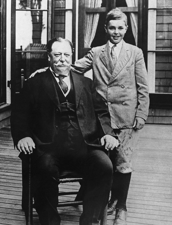 . FILE - This file photo shows President William Howard Taft with his son Charles while on vacation in Beverly, Mass. History buffs know Taft is the only president to later become Supreme Court chief justice, but he\'s also remembered as the president whose weight, at times well over 300 pounds, made headlines. Yet in the early 1900s, way before Weight Watchers, the nation\'s 27th president was helping to usher in a modern approach to treating obesity according to a report released Monday, Oct. 14, 2013, in the journal Annals of Internal Medicine. (AP Photo/File)