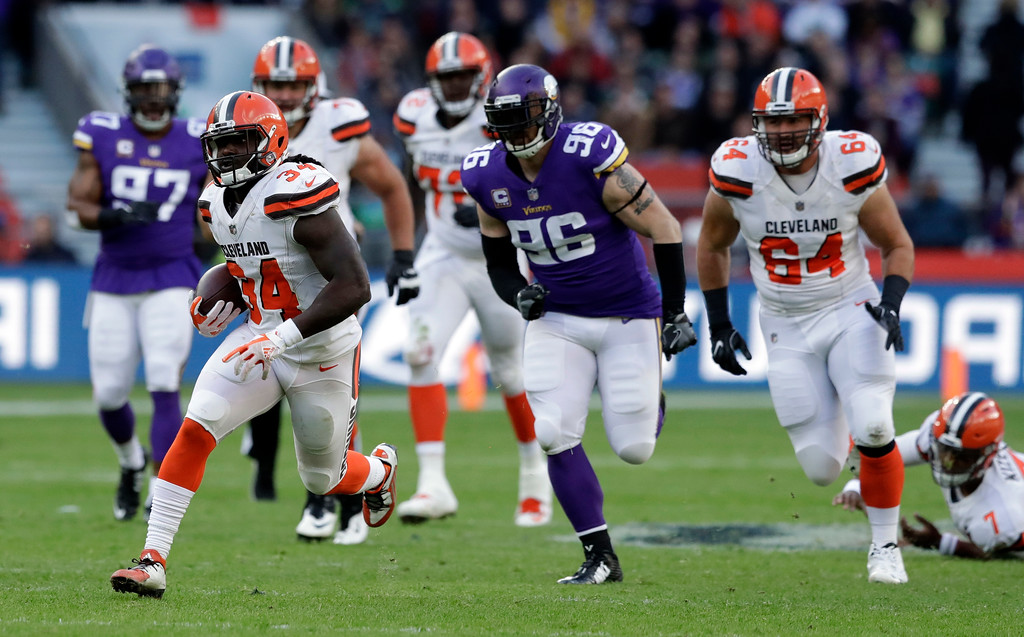 . Cleveland Browns running back Isaiah Crowell (34) runs with the ball as Minnesota Vikings defensive end Brian Robison (96) and Browns center JC Tretter (64) watch during the first half of an NFL football game at Twickenham Stadium in London, Sunday Oct. 29, 2017. (AP Photo/Matt Dunham)