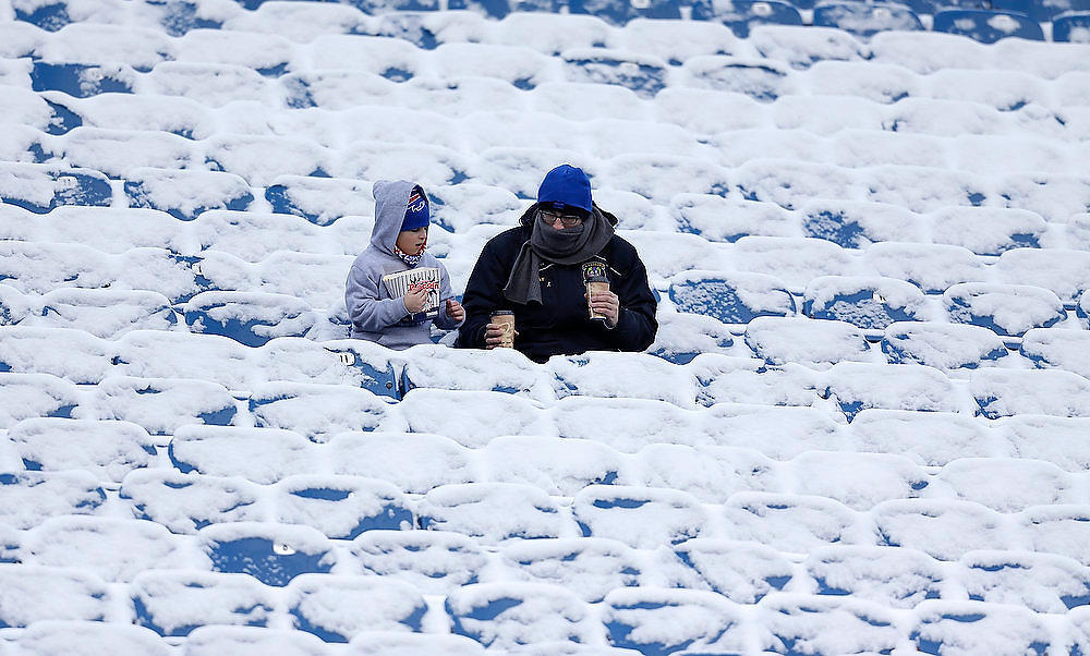 . Fans sit in snow-covered stands at Ralph Wilson Stadium before an NFL football game between the New York Jets and Buffalo Bills, Sunday, Dec. 30, 2012, in Orchard Park, N.Y. (AP Photo/Gary Wiepert)