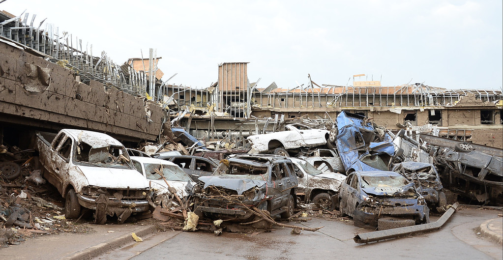 . Dozen of cars  piled up on top of each other at the Moore hospital parking lot. 