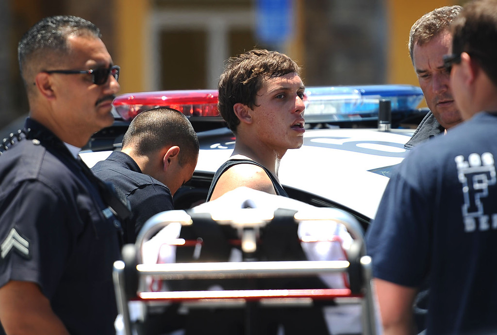 . A man is detained and evaluated by LAPD and fire personnel at Canoga Bowl after he was reported to be suicidal on the Pierce College campus May 30, 2014 in Woodland Hills.  The campus was put on lockdown after around noon Friday.(Andy Holzman/Los Angeles Daily News)