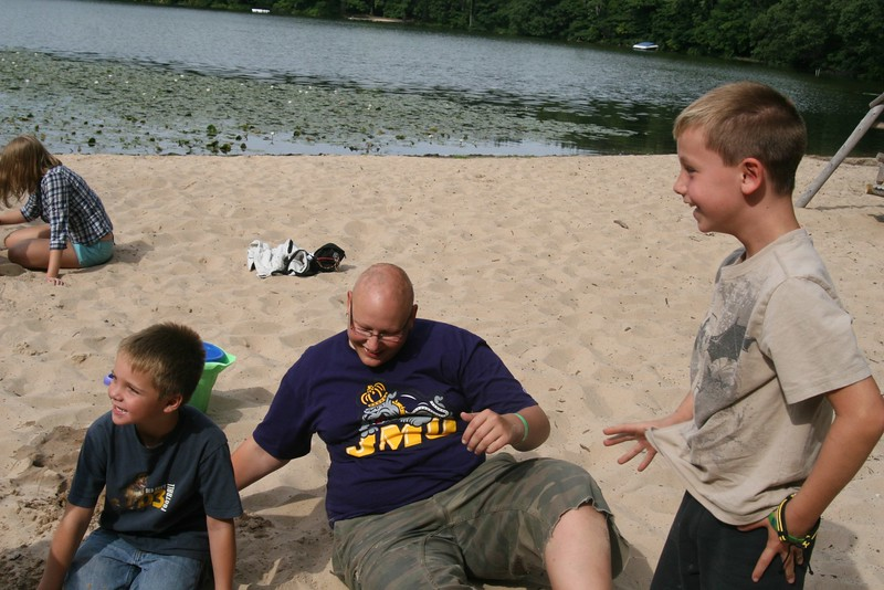 The Outback and All Stars build superhero sand castles together.