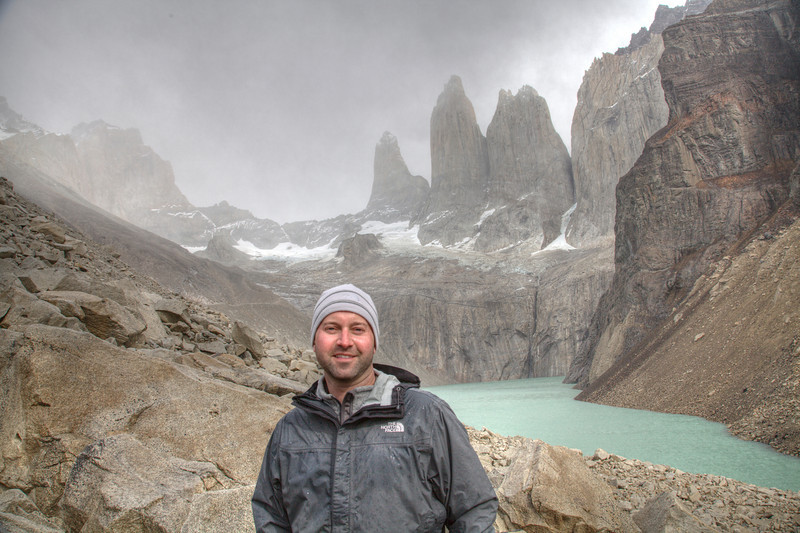 Self-portraint at Base Torres del Paine. It was a 10 km (4.5 hour) hike to get to this point. The day started sunny, but a storm rolled is as we arrived. Rain and 50+ mph winds were raging in this picture. (HDR)