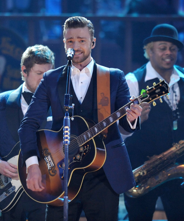 . FILE - In this Nov. 24, 2013 file photo, Justin Timberlake performs on stage at the American Music Awards at the Nokia Theatre L.A. Live in Los Angeles. Timberlake has seven nominations at Sunday, Jan. 26, 2014 Grammy Awards, including best pop vocal album for ìThe 20/20 Experienceî and solo pop performance for ìMirrors.î (Photo by John Shearer/Invision/AP, File)