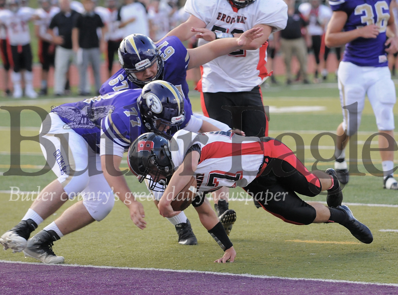 Karns City #77  Stephen Covington goes in to block a pass from Brockway #10 Peter Downer during a game at Karns City Stadium on Friday August 24, 2018.(Jason Swanson photo)