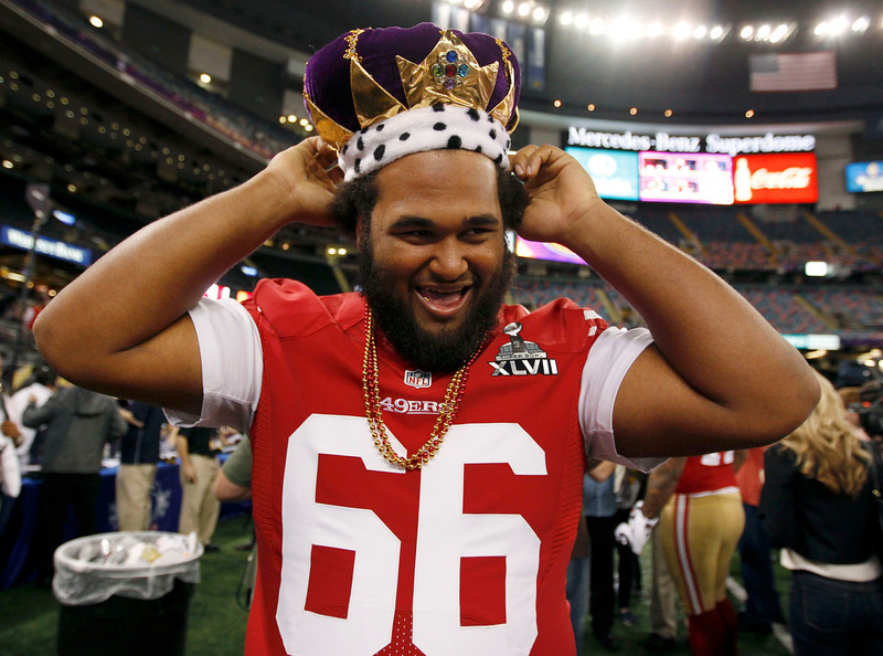 . San Francisco 49ers guard Joe Looney jokes around as he puts on a reporter\'s crown-like hat during Media Day for the NFL\'s Super Bowl XLVII in New Orleans, Louisiana January 29, 2013. The San Francisco 49ers will meet the Baltimore Ravens in the game on February 3. REUTERS/Jeff Haynes