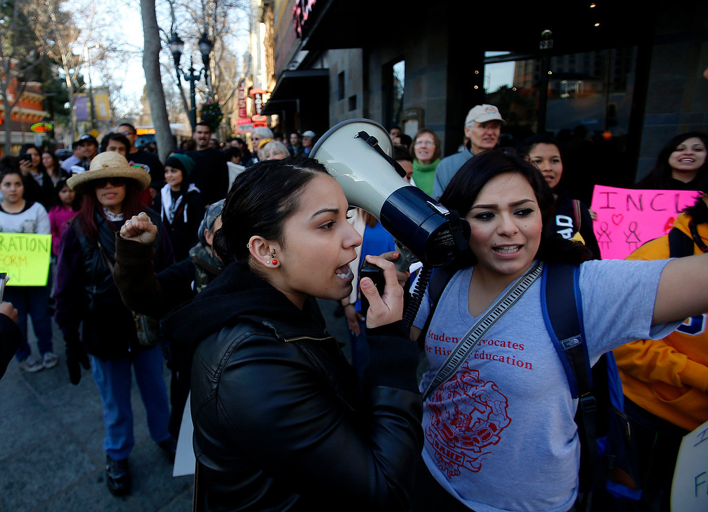 ". Rosie Mendoza, center, and Nayeli Cruz, far right, help lead a march at the corner of S. 2nd and E. San Fernando Streets during an ""Immigration Reform Now\"" rally in San Jose, Calif., on Thursday, Feb. 21, 2013.  They were protesting comprehensive immigration reform.  They began at Dr. Martlin Luther King, Jr. Library and ended at the Robert F. Peckham Federal Building.  (Nhat V. Meyer/Staff)"