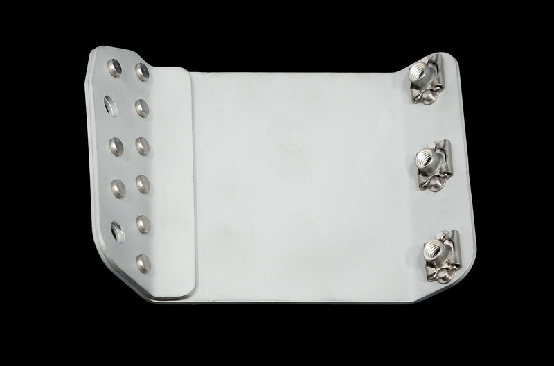 Aluminum aerospace part with rivets and threaded fasteners.