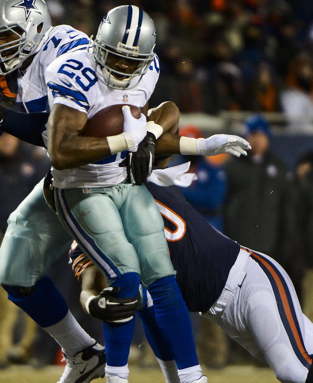 . Dallas Cowboys running back DeMarco Murray (Front) is stopped after a six yard gain by Chicago Bears linebacker James Anderson (Rear) in the first half of their NFL game at Soldier Field in Chicago, Illinois. EPA/TANNEN MAURY