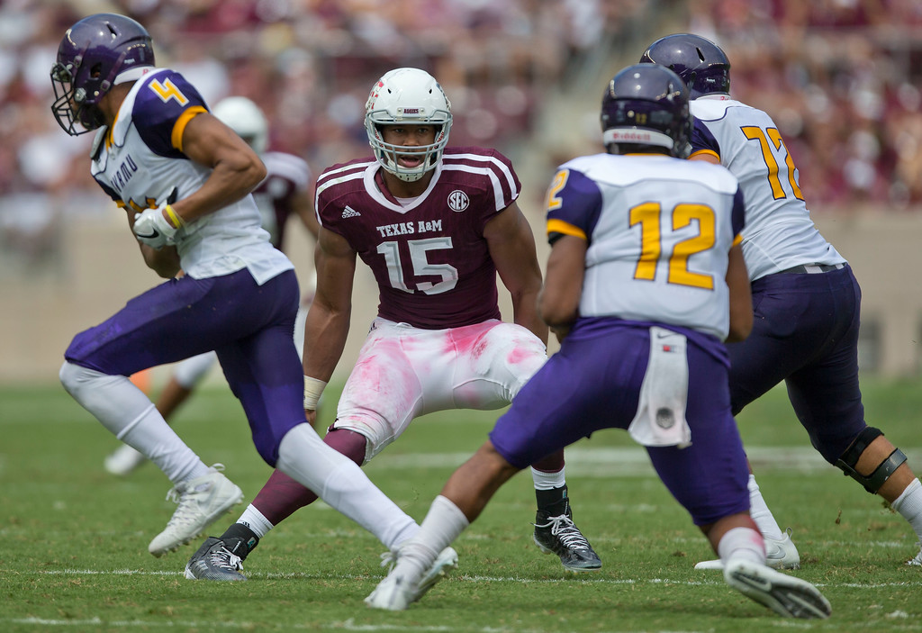 . File-THis Sept. 10, 2016, file photo shows Texas A&M defensive lineman Myles Garrett (15) spying Prairie View A&M quarterback Jalen Morton (12) during an NCAA college football game in College Station, Texas.  Garrett, maybe the best defensive player in the country, against Arkansas left tackle Dan Skipper, a 6-foot-10 NFL prospect. Garrett gets moved around and the Aggies� other end, Daeshon Hall is good, too. It�ll be interesting to see if the long reach of Skipper helps can fend off Garrett, who has three sacks. (AP Photo/Sam Craft, File)