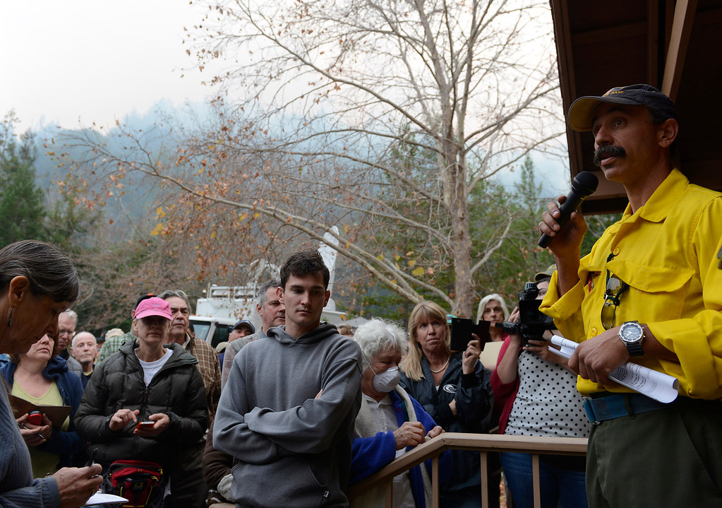 . Big Sur residents, buisness owners, media and others gathered as U.S. Forest Service Incident Commander Mark Nunez, right, gave a briefing on the fire at the Big Sur Staion in Big Sur, Calif. on Tuesday December 17, 2013. (Photo David Royal/ Monterey County Herald)
