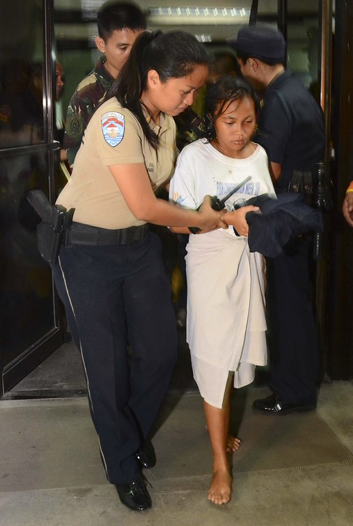 . A survivor (R) is helped as she arrives at hospital early on August 17, 2013 after a ferry collided with a cargo ship off Cebu in the central Philippines. Rescuers in helicopters and boats were on August 17 desperately searching for nearly 300 people missing after the Thomas Aquinas ferry sank in the Philippines, with at least 24 already confirmed killed.         AFP PHOTOSTR/AFP/Getty Images