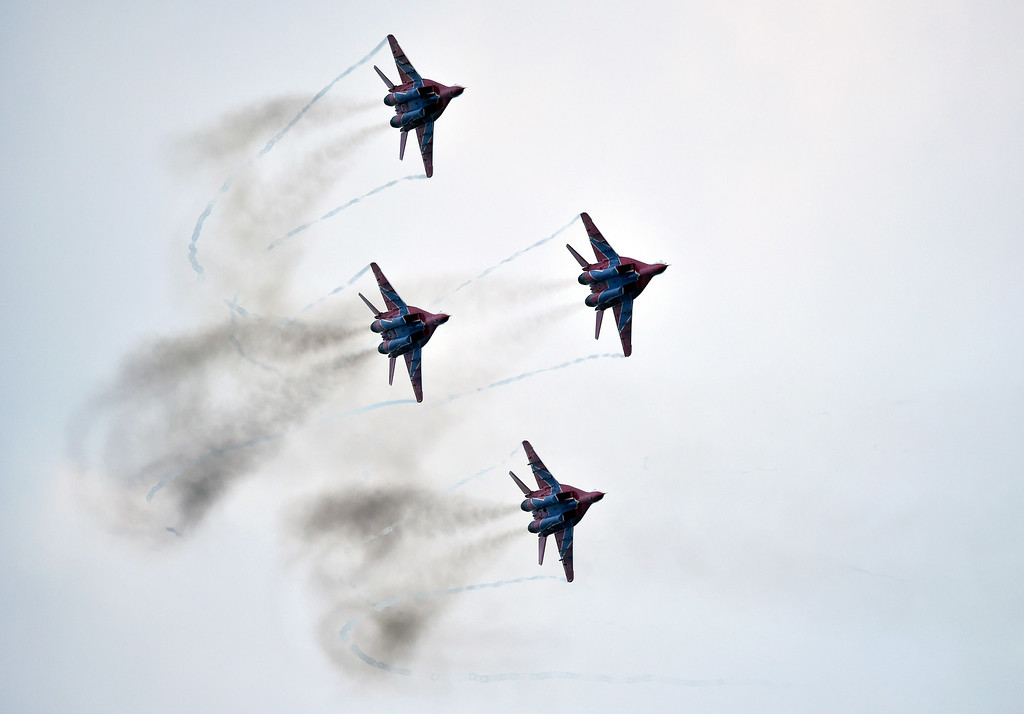 . Russian aerobatic MIG 29 airplanes, part of the Strizhi (The Swifts) group fly during a military parade in Belgrade on October 16, 2014. ANDREJ ISAKOVIC/AFP/Getty Images