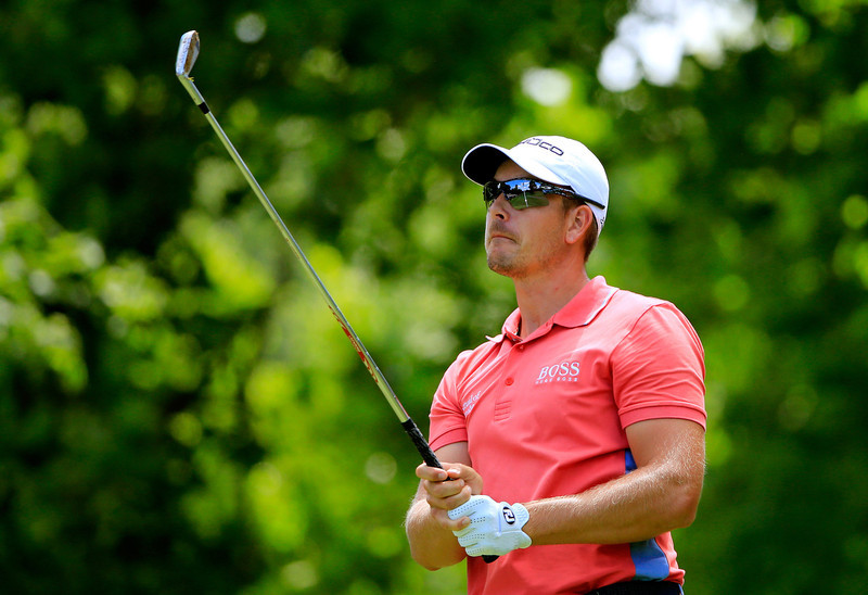 . Henrik Stenson of Sweden hits off the fifth tee during the Final Round of the World Golf Championships-Bridgestone Invitational at Firestone Country Club South Course on August 4, 2013 in Akron, Ohio.  (Photo by Sam Greenwood/Getty Images)
