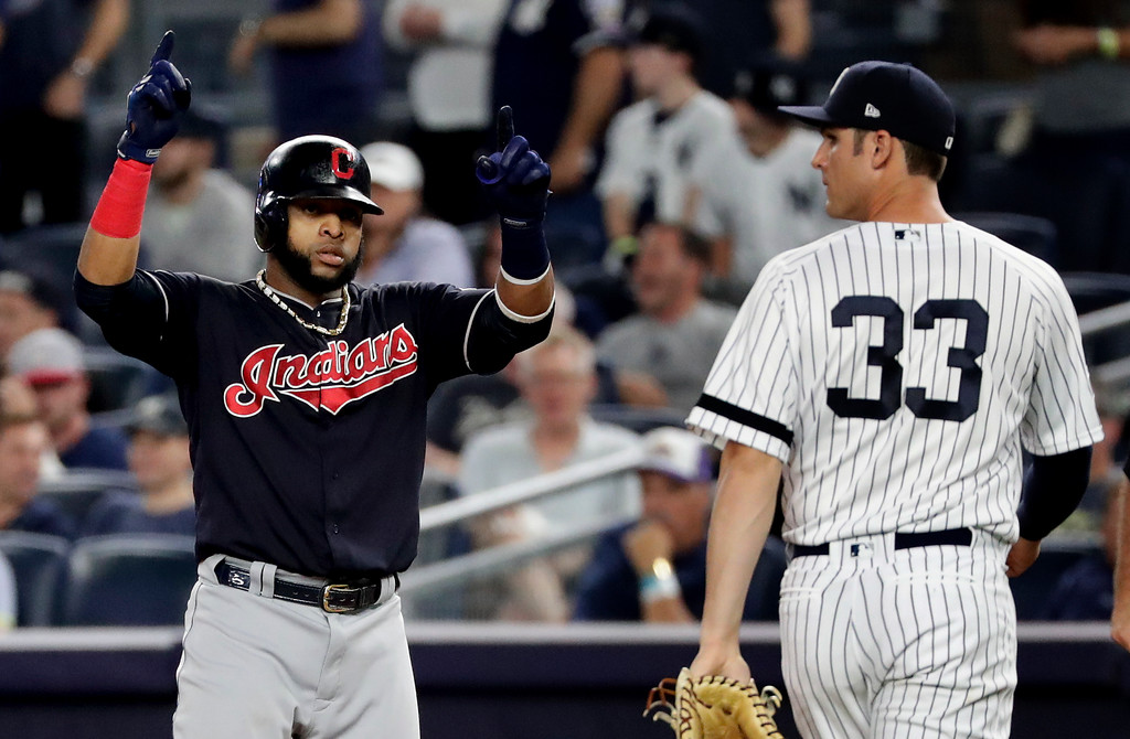. Cleveland Indians first baseman Carlos Santana, left, reacts after reaching first base on a single to right field against the New York Yankees during the second inning in Game 3 of baseball\'s American League Division Series, Sunday, Oct. 8, 2017, in New York. (AP Photo/Frank Franklin II)