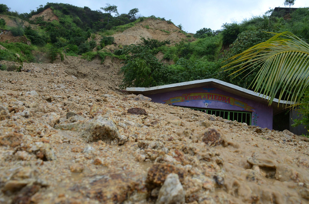 . A small chapel is engulfed in rock and mud from a landslide triggered by heavy rains brought on by Tropical Storm Manuel on the outskirts of Acapulco, Mexico, Monday, Sept. 16, 2013. Tropical Storm Ingrid and remnants of Tropical Storm Manuel drenched Mexico\'s Gulf and Pacific coasts, flooding towns and cities in a national emergency that federal authorities say has caused at least 34 deaths. (AP Photo/Bernandino Hernandez)