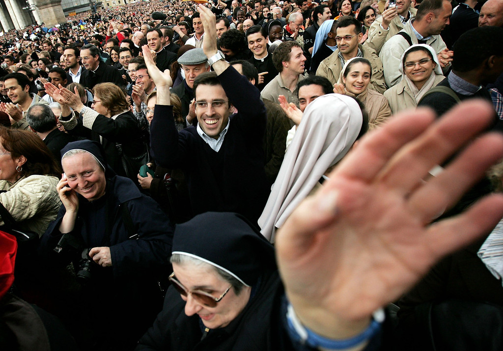 . Crowds gather in St Peter\'s square on April 19, 2005  in Vatican City. German Cardinal Joseph Ratzinger, Pope Benedict XVI, was elected the 265th pope and will lead the world\'s 1 billion Catholics.  (Photo by Chris Jackson/Getty Images)
